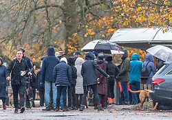 © Licensed to London News Pictures. 1/411/2020. London, UK. Walkers queue at a cafe in Richmond Park as forecasters predict a wet and windy weekend. Walkers in Richmond Park, South West London brave the wind and the rain as the Met Office issue a yellow weather warning for heavy rain in the South East this weekend with wind speeds in excess of 50mph. Photo credit: Alex Lentati/LNP