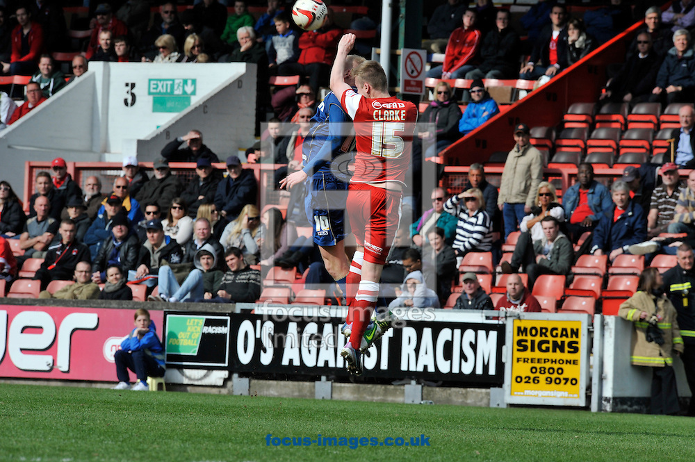 Picture by Alan Stanford/Focus Images Ltd +44 7915 056117.27/04/2013.Nathan Clarke of Leyton Orient and Robbie Simpson of Oldham Athletic challenge for the ball during the npower League 1 match at the Matchroom Stadium, London.. .