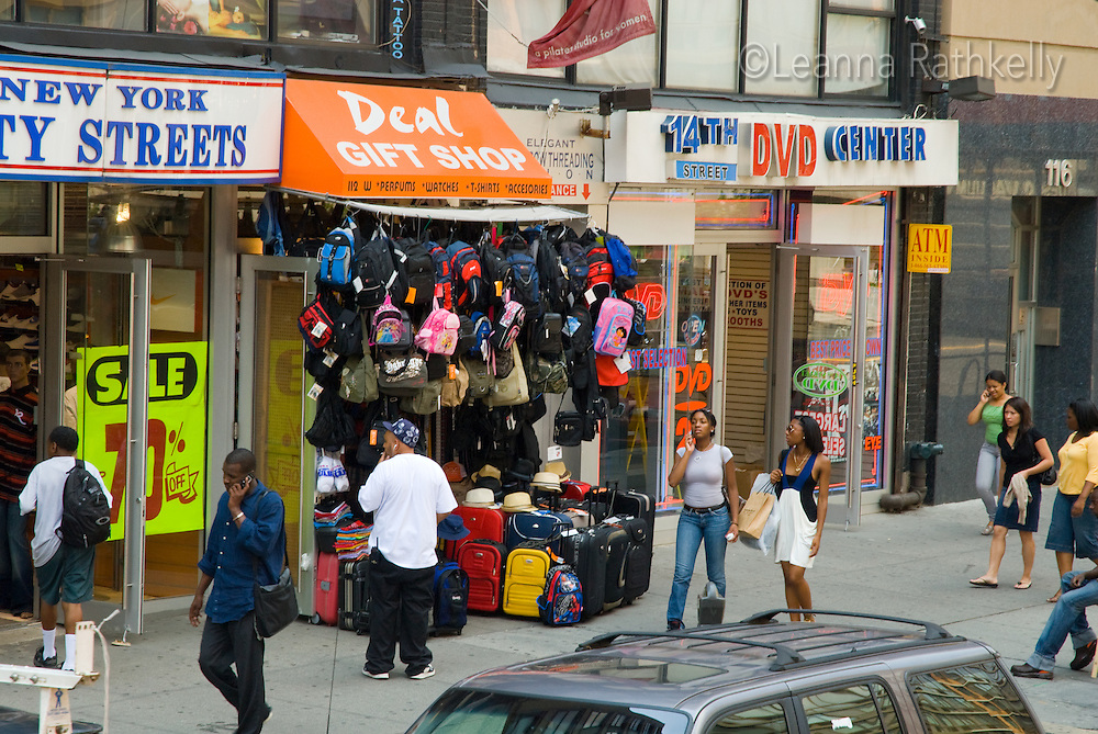 Shops along West 34th street, New York City, NY, USA, feature a variety of goods.
