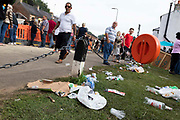 People pass by a large amount of littered rubbish on the grass at Appleby Horse Fair, the biggest gathering of Gypsies and travellers in Europe, on 14th August, 2021 in Appleby, United Kingdom. Appleby Horse Fair attracts thousands from Gypsy, Romany, and traveller communities annually, making it the biggest gathering of its kind in Europe. Generally held for a week every June, the fair was postponed in 2020 and pushed forward to August in 2021 due to Coronavirus.