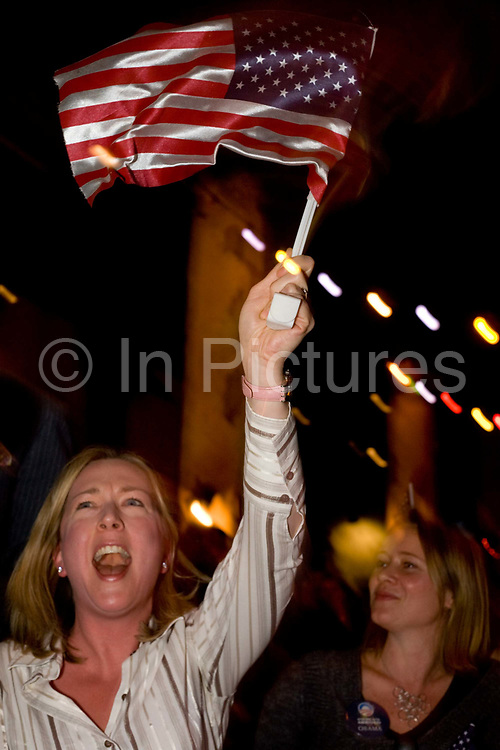 Elated US citizens celebrate at the very moment of Barack Obama's ingauration as the United States' 44th President, after his Nov 08 election victory as America's first African American Commander in Chief. Members of expatriates and 'Democrats Abroad' party supporters wave their hands in the air at The Texas Embassy Texmex bar in central London, England. Similar events were held by Democrats Abroad around the world but in England, Obama's election to the White House excited Britain's political and cultural landscape during a deep economic recession.