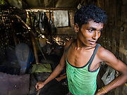 09 NOVEMBER 2014 - SITTWE, RAKHINE, MYANMAR: Rohingya Muslim workers make scythes by hand in a blacksmithing shop in a Rohingya Muslim IDP camp near Sittwe. After sectarian violence devastated Rohingya communities and left hundreds of Rohingya dead in 2012, the government of Myanmar forced more than 140,000 Rohingya Muslims who used to live in and around Sittwe, Myanmar, into squalid Internal Displaced Persons camps. The government says the Rohingya are not Burmese citizens, that they are illegal immigrants from Bangladesh. The Bangladesh government says the Rohingya are Burmese and the Rohingya insist that they have lived in Burma for generations. The camps are about 20 minutes from Sittwe but the Rohingya who live in the camps are not allowed to leave without government permission. They are not allowed to work outside the camps, they are not allowed to go to Sittwe to use the hospital, go to school or do business. The camps have no electricity. Water is delivered through community wells. There are small schools funded by NOGs in the camps and a few private clinics but medical care is costly and not reliable.  PHOTO BY JACK KURTZ