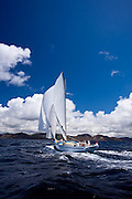 Ocean Nomad, a Carriacou Sloop, sailing in the Windward Race at the Antigua Classic Yacht Regatta.