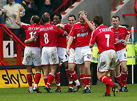 Photograph: Scott Heavey.<br /> Charlton Athletic v Chelsea. FA Barclaycard Premiership. 26/12/2003.<br /> Jason Euell celebrates with his team-mates after making it 4-1