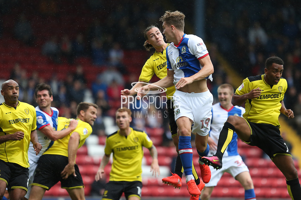 Sam Gallagher of Blackburn Rovers gets ahead of Jackson Irvine of Burton Albion to score the third goal of the game to make it 2-1 during the EFL Sky Bet Championship match between Blackburn Rovers and Burton Albion at Ewood Park, Blackburn, England on 20 August 2016. Photo by Simon Brady.