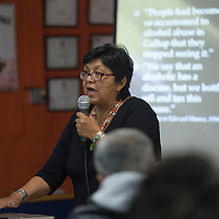 """012815      Cayla Nimmo<br /> <br /> Dr. Jennifer Nez Denetdale, speaks to the historical factors that have lead to the current issues of violence and inequality within the indigenous communities during the Wednesday night forum, """"Gallup: A Border Town of Violence,"""".at the Hozho Center in Gallup."""