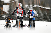 SHOT 2/9/13 5:32:20 PM - Jake Wells (#235) of Avon, Co. climbs uphill while being pursued by Tim Allen (#239) of Golden, Co. during the On-Snow Mountain Bike Crit event at the second annual Winter Mountain Games presented by Eddie Bauer at Vail Ski Resort in Vail, Co. Wells won the Fat Tire Male class and Allen finished second. The Winter Mountain Games feature competitions in X-Country On-Snow Mountain Bike Races, mixed climbing, Telemark Big Air,Best Trick Bike and On-Snow Mountain Bike Crit with more than$60,000 in prize money on the line. (Photo by Marc Piscotty / © 2013)