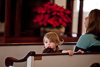 The First Congregational Society welcomes families joining in the Christmas Service on Sunday afternoon at the Smith Meetinghouse in Gilmanton.  (Karen Bobotas/for the Laconia Daily Sun)