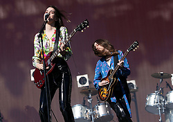 Haim performing on the Other Stage at Glastonbury Festival, at Worthy Farm in Somerset.