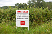 Estate agent Cooper and Tanner property for sale sign at livestock farm Compton Bassett,, Wiltshire, England, UK