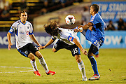 Montreal Impact forward Daniele Paponi (35) and San Jose Earthquakes defender Jason Hernandez (21) battle for the ball in the second half of the game at Buck Shaw Stadium in Santa Clara, California, on September 17, 2013.  The San Jose Earthquakes beat Montreal Impact 3-0. (Stan Olszewski/QMI Agency)