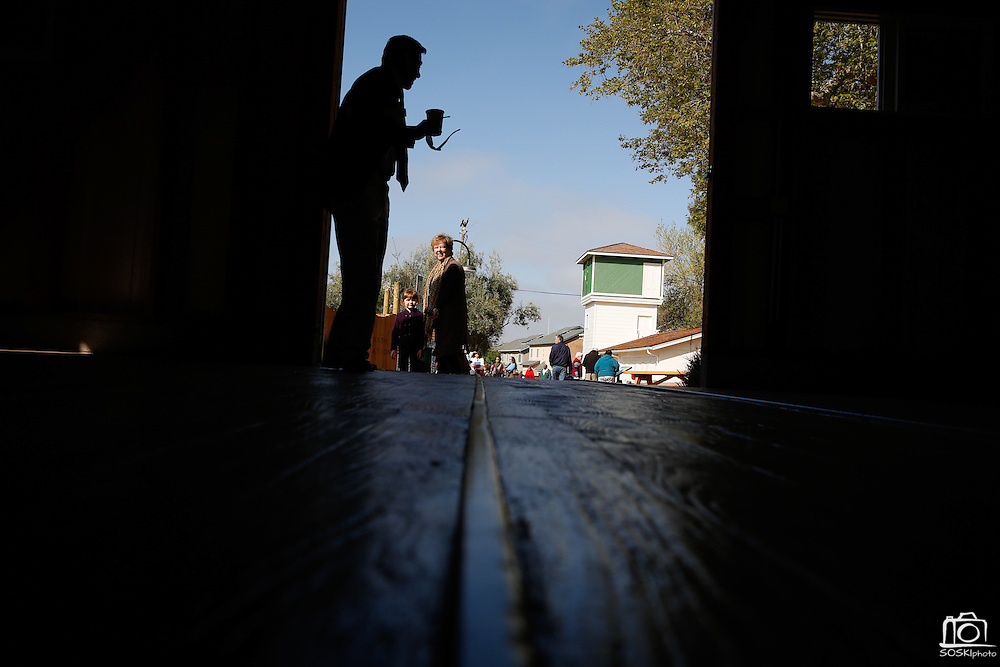 Visitors tour the restored buildings, including the interior of the cutting shed, of the historic apricot farm during the Alviso Adobe Park opening ceremony at Alviso Adobe Park in Milpitas, California, on March 16, 2013. (Stan Olszewski/SOSKIphoto)
