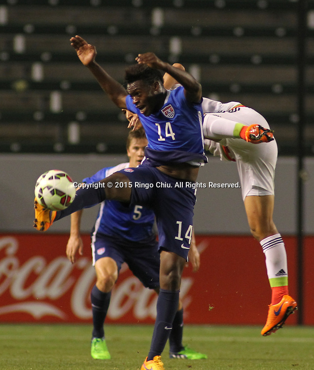 United States' Fatai Alashe #14 actions against Mexico during a men's national team international friendly match, April 22, 2015, at StubHub Center in Carson, California. United States won 3-0. (Photo by Ringo Chiu/PHOTOFORMULA.com)
