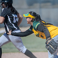 Newcomb Skyhawk Janacia Cayadbitto (8) tosses a grounder to third in an effort to stop Navajo Pine Warrior Ancetta Small (15) Thursday at Tohatchi High School.