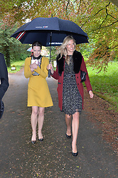 Left to right,  ARABELLA GALLIERS-PRATT and OLIVIA HUNT at the wedding of Princess Florence von Preussen second daughter of Prince Nicholas von Preussen to the Hon.James Tollemache youngest son of the 5th Lord Tollemache held at the Church of St.Michael & All Angels, East Coker, Somerset on 10th May 2014.