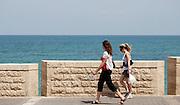 Israel, Tel Aviv-Jaffa, Two women walking on the beach front promenade