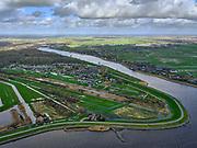 Nederland, Zuid-Holland, Nieuwerkerk aan den IJssel, 25-02-2020; Groenendijk tussen Klein en Ver Hitland. Bij de dewatersnoodvan 1 februari1953 dreigde de rivierdijk hier door te breken (links van de strekdam)  en zouden de polders tot aan Den Haag, Leiden, Gouda ondergelopen zijn (met rampzalige gevolgen). Doordat het binnenvaartschip 'De twee gebroeders' in het gat van de dijk gevaren werd is de ramp voorkomen.<br /> <br /> luchtfoto (toeslag op standard tarieven);<br /> aerial photo (additional fee required)<br /> copyright © 2020 foto/photo Siebe Swart