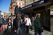 Scene outside Knightsbridge underground station. In a selected few boroughs of West London, wealth has changed over the last couple of decades. Traditionally wealthy parts of town, have developed into new affluent playgrounds of the super rich. With influxes of foreign money in particular from the Middle-East. The UK capital is home to more multimillionaires than any other city in the world according to recent figures. Boasting a staggering 4,224 'ultra-high net worth' residents - people with a net worth of more than $30million, or £19.2million.. London, England, UK.