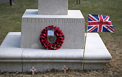 """© Licensed to London News Pictures. 10/07/2020. London, UK. A flag displaying with the words """"DAME VERA RIP"""" on a war memorial in the town of Ditchling, East Sussex, ahead of the funeral of Dame Vera Lynn. The 'Forces' Sweetheart', who died last month aged 103, was famous for singing performances during WW2, which helped raise morale amongst troops abroad. Photo credit: Ben Cawthra/LNP"""