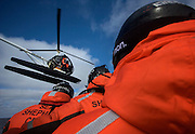 The Sea Shepherd helicopter buzzes overhead while crew in the Gemini inflatable fast boat pursue Japanese harpoon ship, the Yushin Maru No. 2, during a clash in Antarctica's Southern Ocean on Thursday Feb. 5, 2009. (Photo by Adam Lau)