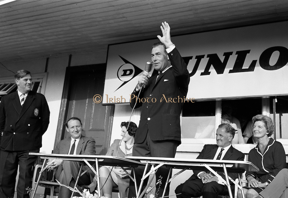 Christy O'Connor waves to the crowd after receiving the first prize for winning the Irish Dunlop £1,000 Tournament at Tramore Golf Club, Co. Waterford on the 19th August 1967.