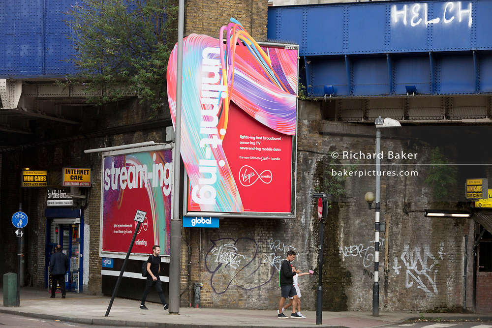 A new ads for Virgin Media fixed to an old Victorian wall beneath Waterloo station in SE1, on 19th August 2019, in London, England.