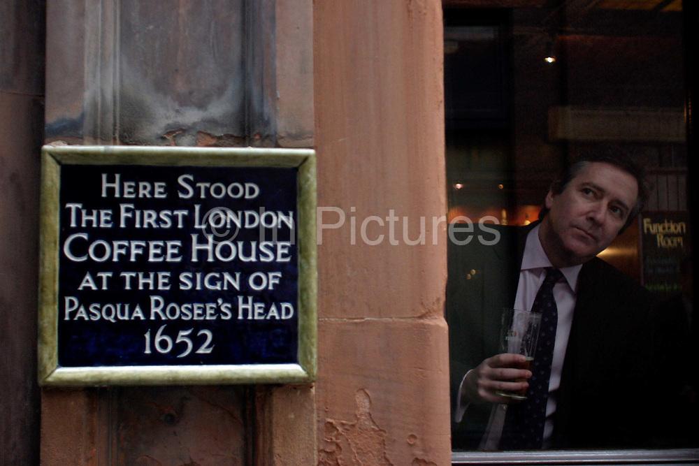 Drinker in the Jamaica Wine House Pub, London, UK