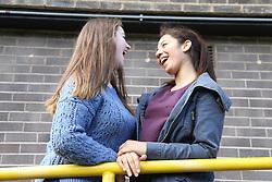 Teenage girls laughing