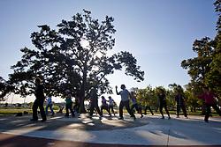Women doing morning aerobic exercises at Storey Park in Houston, Texas