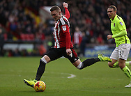 Caolan Lavery of Sheffield United striking the ball towards goal during the English Football League One match at Bramall Lane, Sheffield. Picture date: December 31st, 2016. Pic Jamie Tyerman/Sportimage