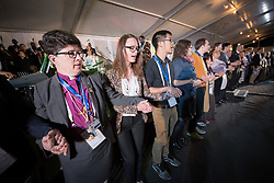 """16 May 2017, Windhoek, Namibia: Sharing a moment of prayer at the closing worship of the Lutheran World Federation's 12th Assembly in Windhoek, Namibia, youth delegates led new LWF Council members to the centre of the worship space, to install them in their new capacities. As the Twelfth Assembly of the Lutheran World Federation is coming to an end, a closing worship service celebrates the LWF Communion and a successful Assembly, and installing the newly elected LWF Council and President. The Twelfth Assembly of the Lutheran World Federation gathers in Windhoek, Namibia, on 10-16 May 2017, under the theme """"Liberated by God's Grace"""", bringing together some 800 delegates and participants from 145 member churches in 98 countries."""