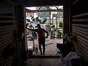 A trainer waits for a horse to be prepared for his student - Armenia - Colombia