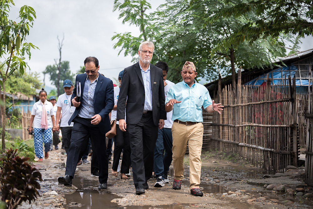 14 September 2018, Damak, Nepal: Rev. Dr Martin Junge (centre) visits the Beldangi refugee camp in the Jhapa district of Nepal, which hosts more than 5,000 Bhutanese refugees. Here, in conversation with camp secretary Tikaram Rasaily (right), himself a refugee. For the past two years, the refugees themselves oversee monitoring, maintenance and governance of the camp. On 12-19 September 2018, the Lutheran World Federation General Secretary Rev. Dr Martin Junge visits Nepal. He will participate in the 75th anniversary celebrations of the Nepal Evangelical Lutheran Church, an LWF member church, and visit development projects run by the church. He will also visit the LWF country program, which is involved in humanitarian relief and development work in a range of areas, supporting refugees, offering relief work to those most affected by the 2015 earthquake, flood victims, among other projects.