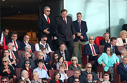 Arsenal's majority shareholder Stan Kroenke (centre) in the stands