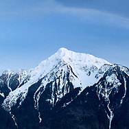 Fresh late-winter snow on Mount Cheam (Lhílheqey).  Mount Cheam is a prominent mountain peak in the Fraser Valley of British Columbia. Located in the Canadian Cascade Range, the peak reaches 2104 meters/ 6903 feet in elevation.   Photographed from Agassiz, British Columbia, Canada.