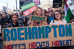 London, November 19th 2014. Thousands of students march through central London, demanding that education fees are scrapped by the government. PICTURED: Roehampton University students demand that government spending prioritises education.