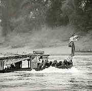 A fishing boat on the Li River. The Cormorant birds at the front are used in a traditional method of fishing. Li River, Guilin, Guangxi Province, China