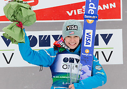 Winner Sarah Hendrickson of USA celebrates during trophy ceremony after the Normal Hill Individual Competition at FIS World Cup Ski jumping Ladies Ljubno 2012, on February 12, 2012 in Ljubno ob Savinji, Slovenia. (Photo By Vid Ponikvar / Sportida.com)