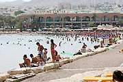 Israel, Eilat Many holidaymakers on the beach