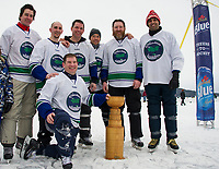 The Stonedam Islanders take the championship in the 30+ Open division Sunday afternoon at the New England Pond Hockey Classic. (l-r) Derek Bekar, Jay Londer, Steve O'Brien, Jason Krog, Shane LaBreton, Aniket Dhadphale and PT Vineberg (kneeling)    (Karen Bobotas/for the Laconia Daily Sun)