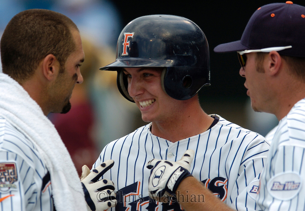 06/20/2006 Cal State Fullerton players celebrate a score during game eleven of the College World Series in Omaha Nebraska Wednesday afternoon..(photo by Chris Machian/Prairie Pixel Group)
