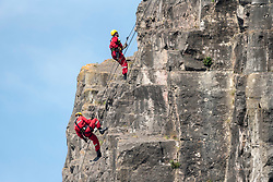 © Licensed to London News Pictures; 11/04/2020; Bristol, UK. Coronavirus Pandemic 2020; Avon Fire and Rescue practice rope access work over the edge of the Avon Gorge in the warm weather on Bristol Downs during a Bank Holiday weekend, during the UK wide coronavirus lockdown with the biggest restrictions on freedom of movement ever imposed in the UK. Police are patrolling parks, and people are told to stay at home except for essential work that cannot be done at home, shopping for food, medical appointments and taking exercise once a day all while maintaining social distance. Photo credit: Simon Chapman/LNP.