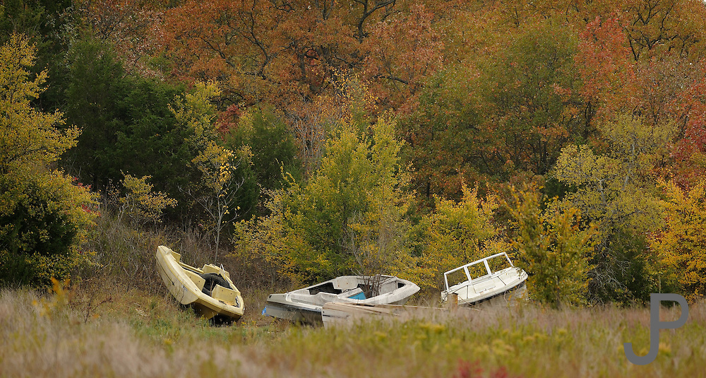 Abandoned boats far from water in a field near Henryetta, Oklahoma