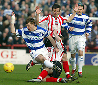 BRENTFORD V QPR <br />PHOTO BY GERARD FARRELL / SPORTSBEAT IMAGES<br />DATE:14/02/2004.<br />QPR'S MARTIN ROWLANDS IN BROUGHT DOWN BY BRENTFORD'S JAY TABB<br />.