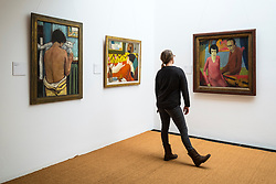 Visitors looking at paintings by Max Kaus at Brücke Museum in Dahlem , Berlin, Germany
