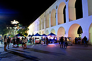 Lapa nightlife, the famous Lapa arches seen here at night. Every weekend, thousands of locals and tourists flock to this district, widely regarded as the place for nightlife in the city. Rio de Janeiro.