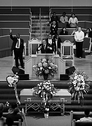 03 June 2014. New Orleans, Lousiana. <br /> Pastor Fred Luter Jr presides over the funeral for teenage shooting victim Dwayne Matthew Joseph at the Franklin Avenue Baptist Church. 17 year old Joseph was shot and killed following an altercation in the street May 26th. Raised by his great grandmother Catherine Robinson, family and friends confirmed Dwayne was a good kid who went to church, looked after his younger siblings and had never been in trouble with the law. Dwayne's older brother Damien preceded him in death. He too was shot dead in February 2011 aged just 19 years.<br /> Photo; Charlie Varley/varleypix.com