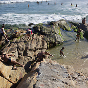 A beach scene at the beachside rock pools at Arpoador beach,  Rio de Janeiro, Brazil. 4th July 2010. Photo Tim Clayton..