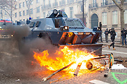 Mcc0086782 . Daily Telegraph<br /> <br /> DT News<br /> <br /> An armoured Police vehicle drives over a burning barricade.<br /> <br /> Scenes on the on Ave de Freidland and Blvd Hausmann as protests turn violent in Paris for another weekend .<br /> <br /> Paris 8 December  2018
