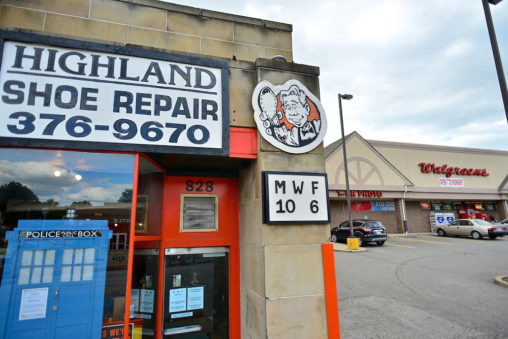 Signage at Highland Shoe Repair.